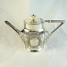 Victorian Ornate Silver Plated Tea Service. Click on the image for more information.