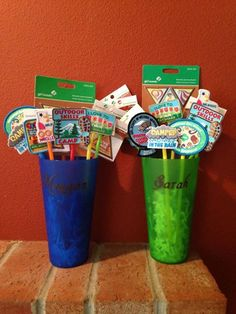 Here's a cool way to give your Girl Scouts the patches they earned. We decorated plastic cups with their names cut out of vinyl using Cricut Divine Wedding Font. We attached the patches and pins to colorful straws.
