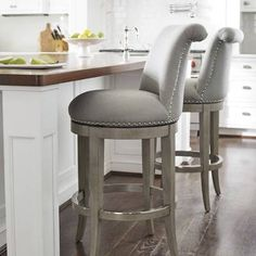 The graceful silhouette and curved back of our Ellison Barstool imbue a room with elegance. Solid-hardwood frame finished and generously cushioned seat with linen upholstery.Solid hardwood frameCurved seat backHand-applied antiqued-brass nailhead trimLifetime-guaranteed, 180 return swivel