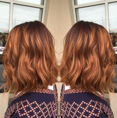 This pumpkin spice balayage 'do looks awesome with soft waves.