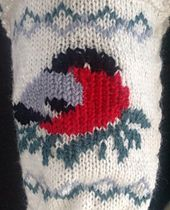 These socks are knitted and the birds are sewn on afterwards