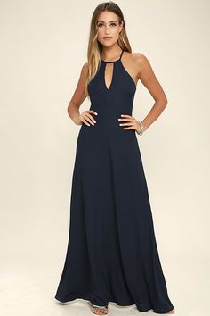 Catch everyone's attention as you glide on to the dance floor in the Beauty and Grace Navy Blue Maxi Dress! A high, halter neckline, with a keyhole cutout, tops a sleeveless bodice with a racerback. Woven poly sweeps down into a figure skimming maxi skirt. Hidden back zipper.