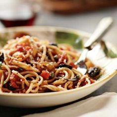 Spaghetti Puttanesca - An Italian classic, this flavorful pasta sauce known as puttanesca combines tomatoes, onions, capers, black olives anchovies, oregano and garlic; a dash of red pepper flakes adds a spicy kick.