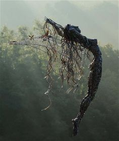The artists slowly twist wires around each other.  _wire sculptures by Robin Wight