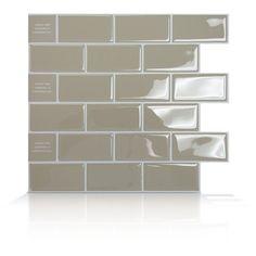 "Peel and stick ""glass"" backsplash tiles... A renter's dream!"