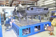 A Camaro on the behemoth Air Force frame table.