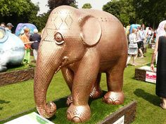 A penny covered elephant featured in London's Elephant Parade