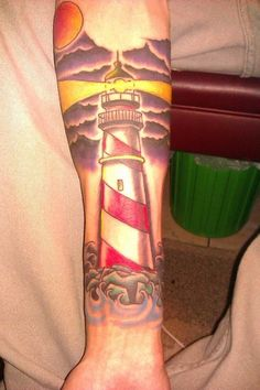 This is a picture of my first and only tattoo right after it was finished. It's a traditional light house to commemorate my Grandfather, done by Sean Green at Shamrock Tattoo in Daytona Beach, Florida.