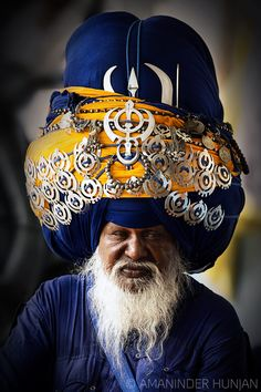 Portrait of a Nihang (A Sikh warrior)  Name- Ranjit Singh  He ties 300 meter turban twice a day and it takes 2 hours to tie turban (Dumala). Turban is also called Dumala or Boonga. its his FAITH towards his Religion and Culture...  © All rights reserved  AMANINDER HUNJAN PHOTOGRAPHY