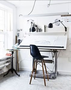 Love the lighting... it's lacking color, but I love the idea of having a desk right by the window... it being a bright, well-lit room.