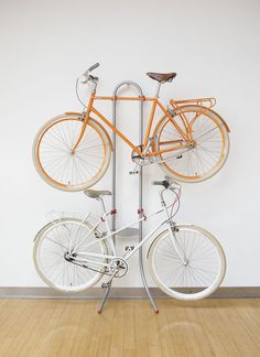 <b>It's about time you started hanging your bicycle on the wall like a civilized person instead of letting it clutter up that hallway.</b> Here are some DIY options, as well as some very nice looking bike racks you can purchase if you've got the budget for it.