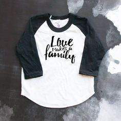 It is not always blood that makes a family - it is those who love you, the people that are there for you every step of the way make your family. As an adoptive family, we know love made our family. It doesnt matter that we look different, we are family.  All items purchased are made to order. Most orders ship in 1-2 weeks, custom orders may take longer. All baby bodysuits and t-shirts are 100% cotton. Vinyl heat transfer material is used for the design. This tee comes in a black and white…