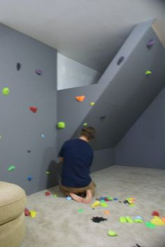 My awesome friends made a climbing wall for their kids in the basement.