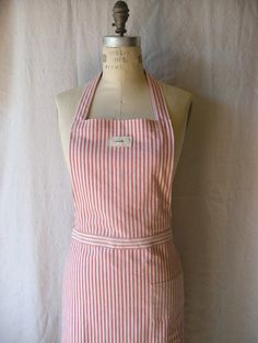 red and white striped apron.