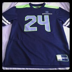 Marshawn Lynch jersey shirt Seattle Seahawks #24 Marshawn Lynch jersey shirt. 100% polyester, has a few snags as seen in pic 3&4. Offers welcome!! Men's large & true to size. Nfl Tops