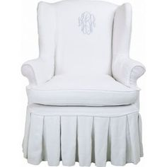 love a pleated skirt and a monogram on a chair