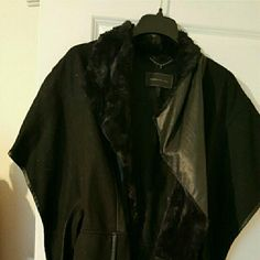 Like new poncho wrap Worn 2 times, in great condition.  Leather  trim. Size  M/L BCBGMaxAzria Jackets & Coats Capes
