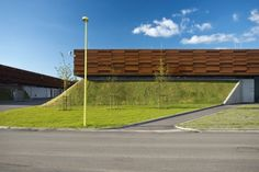 This gas compressor station in southern Denmark by CF Møller Architects comprises Corten steel-clad boxes atop a pair of artificial hills. Building Exterior, Exterior Siding, Building Facade, Green Building, Building Design, Factory Architecture, Facade Architecture, Compressor Station, Gas Compressor