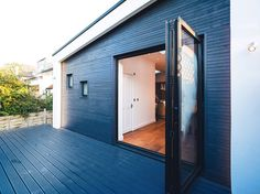 A striking extension finished in black timber cladding, designed by PLANSTUDIO. Lewisham, London