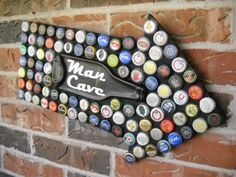 Man Cave Sign Beer Bottle Caps Mosaic with Melted Beer Bottle. $50.00, via Etsy.