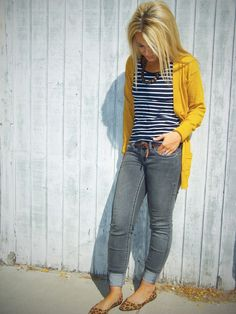 The perfect casual, Jeans Friday outfit. Jeans with a striped navy shirt and a mustard colored cardigan and flats.