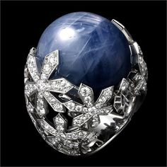 Cartier; star sapphire, white gold and diamonds.