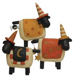 Halloween resin sheep are decked out for fall.