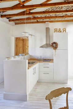 small rustic cabin, white and wood kitchen