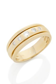 5 Diamonds set into a Yellow Gold channel edge band.