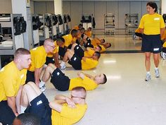 Culinary Specialist 1st Class Pam O'Neil leads recruits in her division during an in-house session of physical fitness for strengthening and conditioning at Recruit Training Command (RTC).