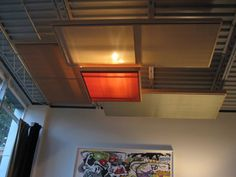 Simple fabric panels can soften the look of a vaulted or industrial-style ceiling.