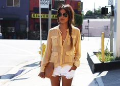 casual summer outfit. peach top, white cut-off shorts.