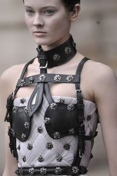 As I've pointed out before, bondage is NOT fashion!  McQueen, Fall 2011