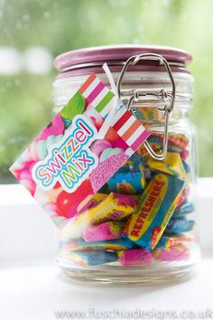Swizzle Mix sweets in glass Kilner jar. Part of the Fuschia Pic N Mix Candy Bar.  Perfect for weddings, mehndi, celebrations. Complete with sweetie bags, scoops, tags and signage! www.fuschiadesigns.co.uk