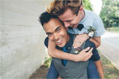 Urban Gay Wedding / Elopement in Chattanooga, Tennessee. Blue monochromatic styling. Piggyback laughing same-sex male couple.
