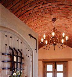 "entry with authentic ""Bovida de Canyon"" (brick ceiling) and custom door - David Peterson"