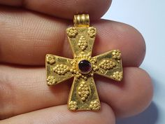 LATE ROMAN GOLD CROSS. Circa 6th century AD. A gold cross finely constructed of gold with decorative granulation and red carnelian gem in the centre. | eBay!