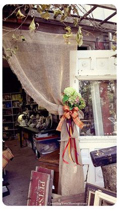 Simple burlap curtain with tiebacks easily changed seasonally (pinned from Counting Your Blessings)