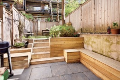 Great deck/planter/stair combo. Might be good for our backyard.