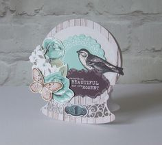 Tattered Lace Snow Globe die for base card shape then decorated using Kaisercraft products.