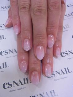 Soft pink ombre nails.