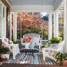 A covered porch or patio is a perfect place to create a casual seating arrangement for gathering with friends. Love the contrast of patterns.