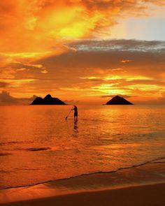 A standup paddler heads out for a workout off of LaniKai Beach, Hawaii.