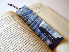 "Bookmark: ""Storm"" - I love the silhouette lighthouse and the tangled white clouds on the dark blue sky"