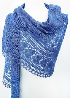What a stunning lace shawl! I think what makes it look even more special is her choice of yarn.
