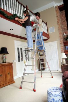 We've engineered Little Giant ladders to help you be safe, especially while decorating your home for the holidays. Hang garlands, lights and decorations for Christmas safely and easily with a Little Giant!  #laddersafety #Christmas #decorating #ladder