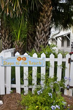 1000 miles to home but who is counting:  White picket fence and a cute rustic sign - one can't go wrong....