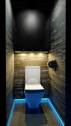 Tiny bathroom with floor light, dark walls