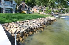 A glacial stone seawall is an alternative to a concrete or steel bulkhead seawall. Description from tippecanoewatershed.org. I…