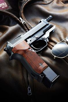 Beretta M93R, beautiful wood grip and compensated barrel :) Oh the extended mag is a plus too!: